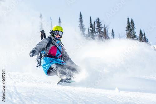 fototapeta na ścianę Snowboarding in the winter