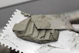 cement steel trowel closeup - 106191232