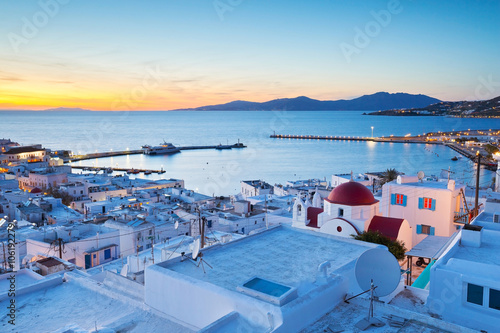 Foto Murales View of Mykonos town and Tinos island in the distance, Greece.