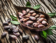 Cocoa pod and Cocoa beans on the wooden table.