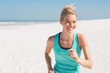 Fototapety Woman jogging at beach