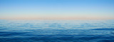 Fototapety Panorama of sea waves on the background of dawn