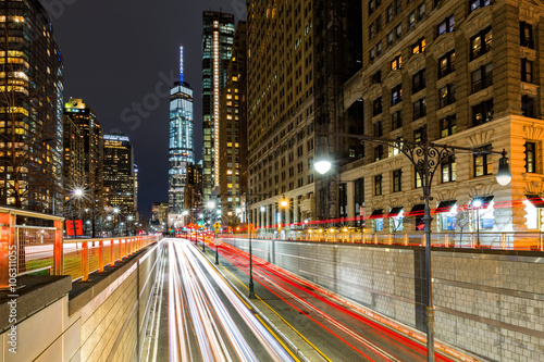 Traffic trails in downtown New York City at the entrance in Battery Park tunnel Poster
