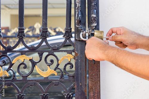 Poster man fix lock master on old blue steel