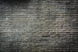 Ciemny ceglany mur tle