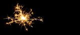 Fototapety Christmas sparkler on black background. Bengal fire