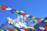 Colorful prayer flags and  Ama Dablam, Everest region, Nepal