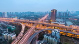 city interchange at dusk to night in hangzhou , road junction of urban expressway,time lapse.