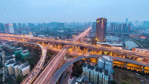 Foto op Aluminium Nacht snelweg city interchange at dusk to night in hangzhou , road junction of urban expressway,time lapse.