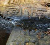 Carvings of lotus flowers rock