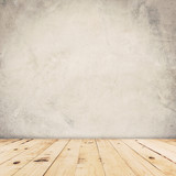 Fototapety Cement wall background and wood floor with space