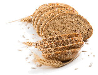 Bread slices and stalks of wheat.