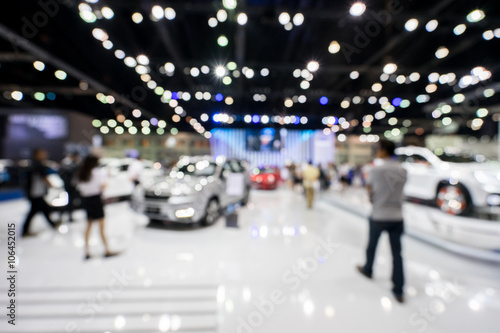 In de dag blur photo of motor show, car show room