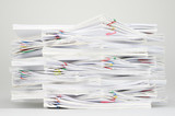Overload document with colorful paperclip on white table