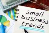 Small Business Trends written in a notepad. Business concept.
