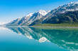 Mountains reflecting in still water, Glacier Bay National Park, Alaska, United States
