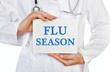 Doctor holding a card with Flu Season, medical concept