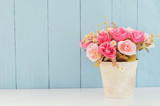 Fototapety Pastel Artificial Pink Rose in flower pot