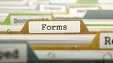 Forms on Business Folder in Multicolor Card Index. Closeup View. Blurred Image. 3D Render.