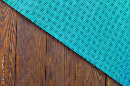1332e7e4b0812 Detail of perforated blue yoga mats on the wooden background. Texture yoga  mats and boards