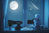 child little girl at window dreaming and admiring starry sky at - Fine Art prints