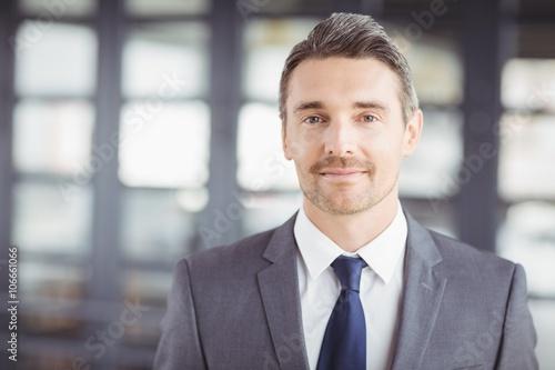 Portrait of confident handsome businessman