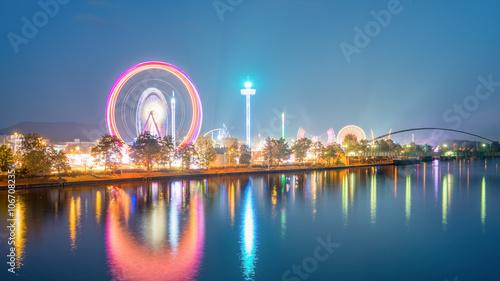 Fotobehang Amusementspark Spring Festival Stuttgart - Germany, long exposure with ligthtrails