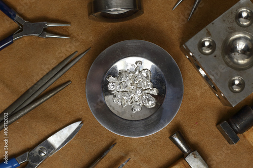 obraz lub plakat Tools of jewellery. Jewelry workplace on leather background. Top view