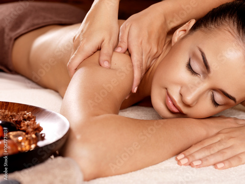 Poster Woman having massage in the spa salon