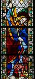 Saint Michael trampling Satan