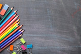 School supplies on blackboard background - 106815075