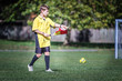 Young soccer referee on the field