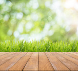 Fototapety Bright spring or summer with nature grass field background and wooden floor