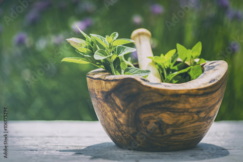 Herbs - Fresh herbs in a mortar (filtered)