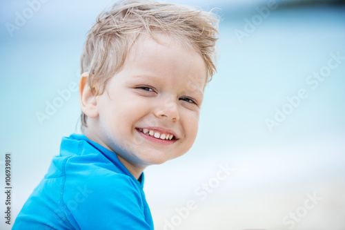 Smiling little boy on the beach