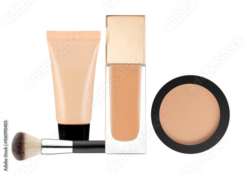 powder, liquid makeup foundation in tube and brush isolated on w