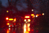Emergency Vehicles Flashing Through a Wet Windshield Darkly