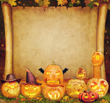 Halloween background scroll sign with foliage and carved orange pumpkins