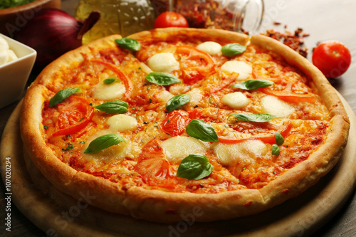 Fotobehang Restaurant Margherita pizza with tomatoes and spices on wooden background