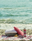 Fototapety Breakfast on the beach. Coffee and croissants on the sea. Pillow