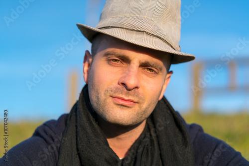 Man in hat looking at camera