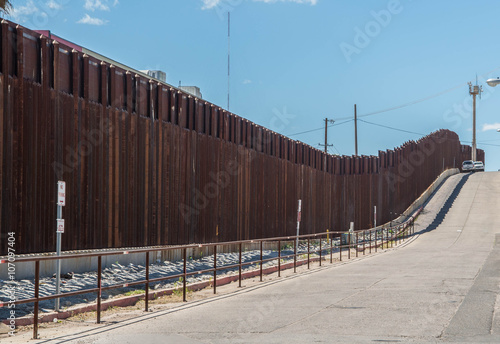 Poster Arizona Border fence in Nogales Arizona separating the United States from Nogales Sonora Mexico