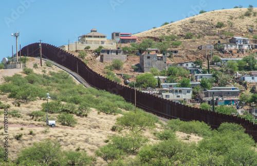 Deurstickers Arizona Border fence looking from Nogales Arizona into Nogales Sonora Mexico
