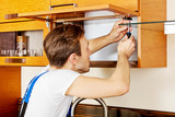 Handyman fixing kitchen