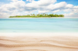 Fototapety Sandy tropical beach with island on background