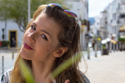 young beautiful woman looks like cute girl enjoying sunny holidays