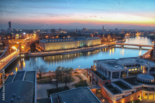 Foto op Canvas WROCLAW, POLAND - APRIL 02, 2016: Aerial view of Wroclaw. Illuminated city skyline during a beautiful sunset, April 02, 2016 in Wroclaw, Poland.