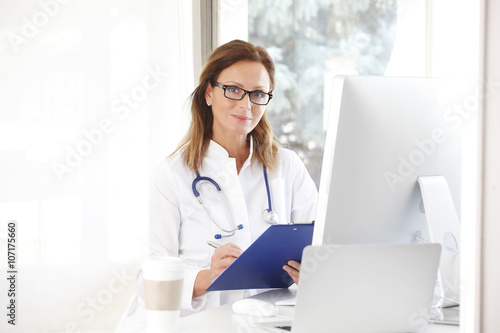 Female Doctor In The Office Poster