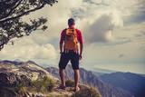 Hiking man or trail runner in inspiring mountains