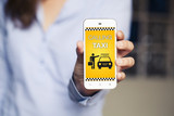 Fototapety Calling Taxi message on a mobile phone screen. Woman hand holding a smartphone with taxi booking software.
